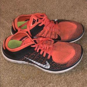 Gray and Orange Nike Flyknit